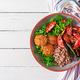 Meatballs, salad of tomatoes and buckwheat porridge on white wooden table.  - PhotoDune Item for Sale