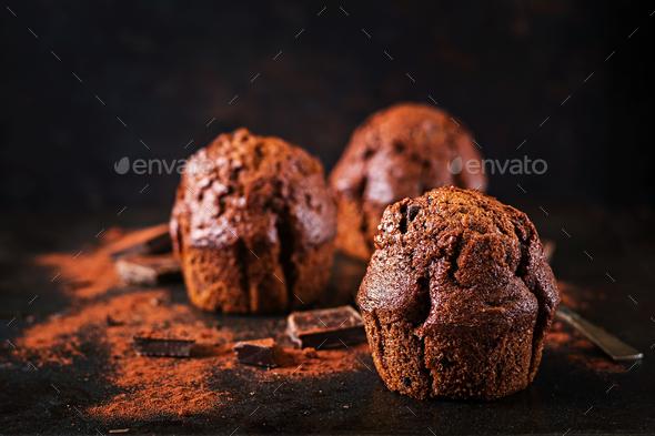 Chocolate muffin on dark background. - Stock Photo - Images