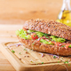 Salmon sandwich - smorrebrod with cheese cream and microgreen on wooden table. - PhotoDune Item for Sale