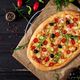Delicious seafood shrimps and mussels pizza on a black wooden table. Italian food. Top view - PhotoDune Item for Sale
