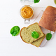 Freshly baked  spinach bread on a white wooden table. Rustic style. Bakery food.Top view - PhotoDune Item for Sale