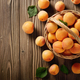 Top view of Wicker basket with ripe apricots on wooden table. Pl - PhotoDune Item for Sale