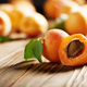 Ripe organic apricots on wooden table closeup - PhotoDune Item for Sale