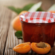 Glass Jar of Apricot jam on wooden table with ripe apricots asid - PhotoDune Item for Sale