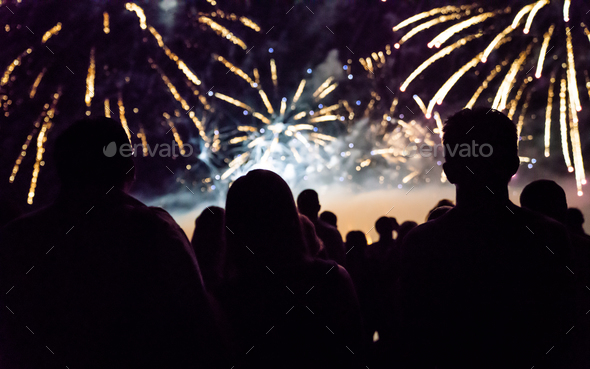 New year concept - cheering crowd and fireworks - Stock Photo - Images