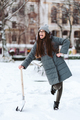 Beautiful girl in winter fashion clothes with a shovel - PhotoDune Item for Sale