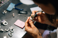 The girl works on a jewelry in the workshop - PhotoDune Item for Sale