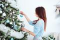Girl dresses up Christmas tree - PhotoDune Item for Sale