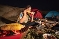 group of friends having fun camping, eat roasted corn - PhotoDune Item for Sale