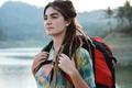 portrait caucasian woman looking around the river - PhotoDune Item for Sale