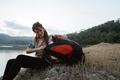 close up caucasian woman alone sitting side lake - PhotoDune Item for Sale
