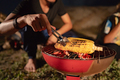 group of friends having fun camping, making roasted corn - PhotoDune Item for Sale