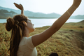 portrait of woman with raised hands on beautiful sunrise - PhotoDune Item for Sale