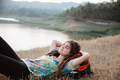 beautiful woman lay on grass enjoy the traveling - PhotoDune Item for Sale