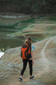 woman hiker alone enjoy the beauty of nature, back view - PhotoDune Item for Sale