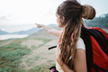 pose caucasian woman with backpack pointing the direction - PhotoDune Item for Sale