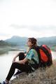 portrait caucasian woman alone sitting side lake - PhotoDune Item for Sale