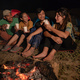 group of friends camping, sitting around camp fire - PhotoDune Item for Sale