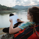 caucasian woman alone sitting side lake and writing note - PhotoDune Item for Sale
