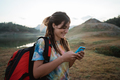 caucasian woman hiker alone enjoy the beauty of nature with smar - PhotoDune Item for Sale