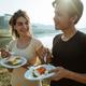 portrait caucasian woman and asian man enjoy breakfast in side l - PhotoDune Item for Sale