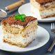 Two piece of traditional italian Tiramisu dessert cake on a whit - PhotoDune Item for Sale