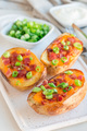 Baked loaded potato skins with cheddar cheese and bacon on ceram - PhotoDune Item for Sale