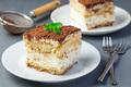 Two piece of traditional italian Tiramisu dessert cake on a whit - PhotoDune Item for Sale
