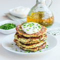 Vegetarian zucchini fritters or pancakes, served with greek yogu - PhotoDune Item for Sale