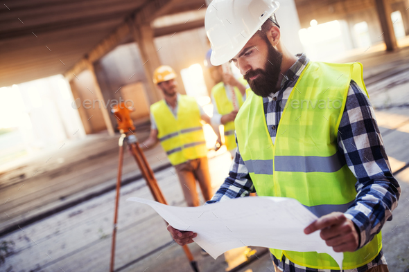 Picture of construction engineer working on building site - Stock Photo - Images