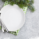 Free Download Christmas table setting with empty plate, silverware Nulled