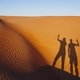 Shadows of two friends on sand dune - PhotoDune Item for Sale