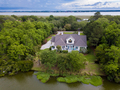 Aerial view of waterfront home on wooded property - PhotoDune Item for Sale