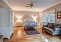 Elegant bedroom with hard wood floors and tasteful furniture - PhotoDune Item for Sale