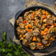 Free Download Beef stew with vegetables in iron pan on black Nulled