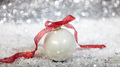 Christmas ball and snow, abstract bokeh lights background - PhotoDune Item for Sale