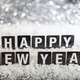 Free Download Happy new year on snow, abstract bokeh lights background Nulled