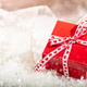 Free Download Christmas gift box on abstract bokeh lights and glitter background Nulled