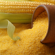 Ripe fresh organic sweet corncob and wooden bowl closeup on grit - PhotoDune Item for Sale