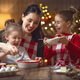Free Download Family cooking Christmas cookies. Nulled