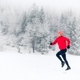 Free Download Happy girl running on snow in winter mountains Nulled