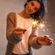 Free Download Close-up of sparkler in woman hands Nulled