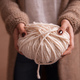 Free Download Close-up of yarn clew with knitting needles in female hands Nulled
