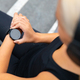 Free Download Close-up of woman using fitness smart watch device before running Nulled