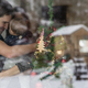 Free Download Young couple with a baby standing next to a decorated Christmas Nulled