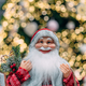 Happy Santa on background of bokeh christmas tree - PhotoDune Item for Sale