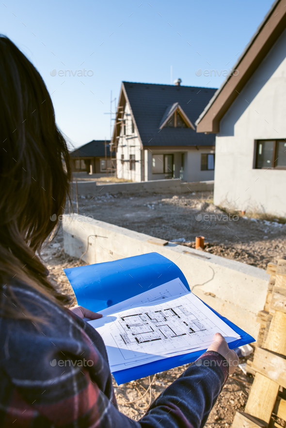 New build house and blueprints - Stock Photo - Images