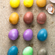 Peeled Colorful Easter eggs background, top view - PhotoDune Item for Sale