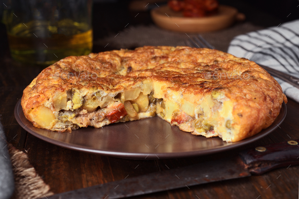Real homemade spanish omelette with chorizo and vegetables - Stock Photo - Images