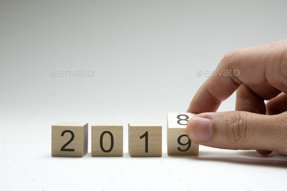Hand flipping wood cube changes from 2018 to 2019 - Stock Photo - Images